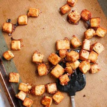 Sesame ginger baked tofu on a baking sheet